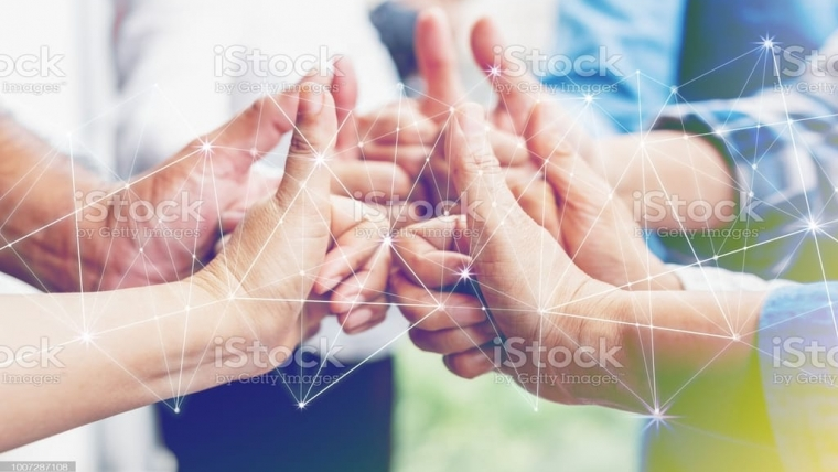 Business partners team achievement concept. Multi-ethnic diverse group of colleagues join hands together. Creative teamwork,business agreement. Important of teamwork.